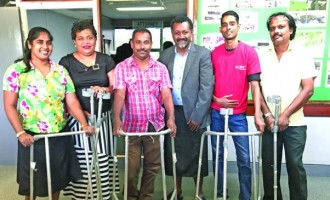 Six Geared With New Walkers And Crutches