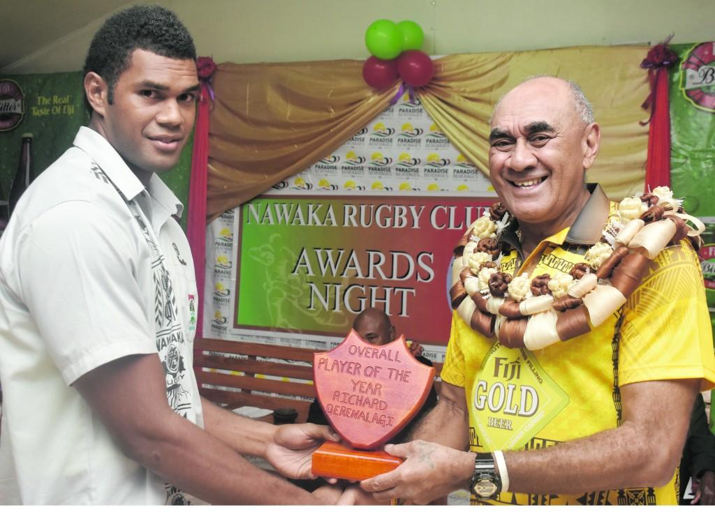 Richard Derenalagi receives his award from Paradise Beverages general manager Sales and Corporate Affairs Joe Rodan at the Nawaka Rugby Club inaugural awards night in Nadi on Friday night. Photo: WAISEA NASOKIA