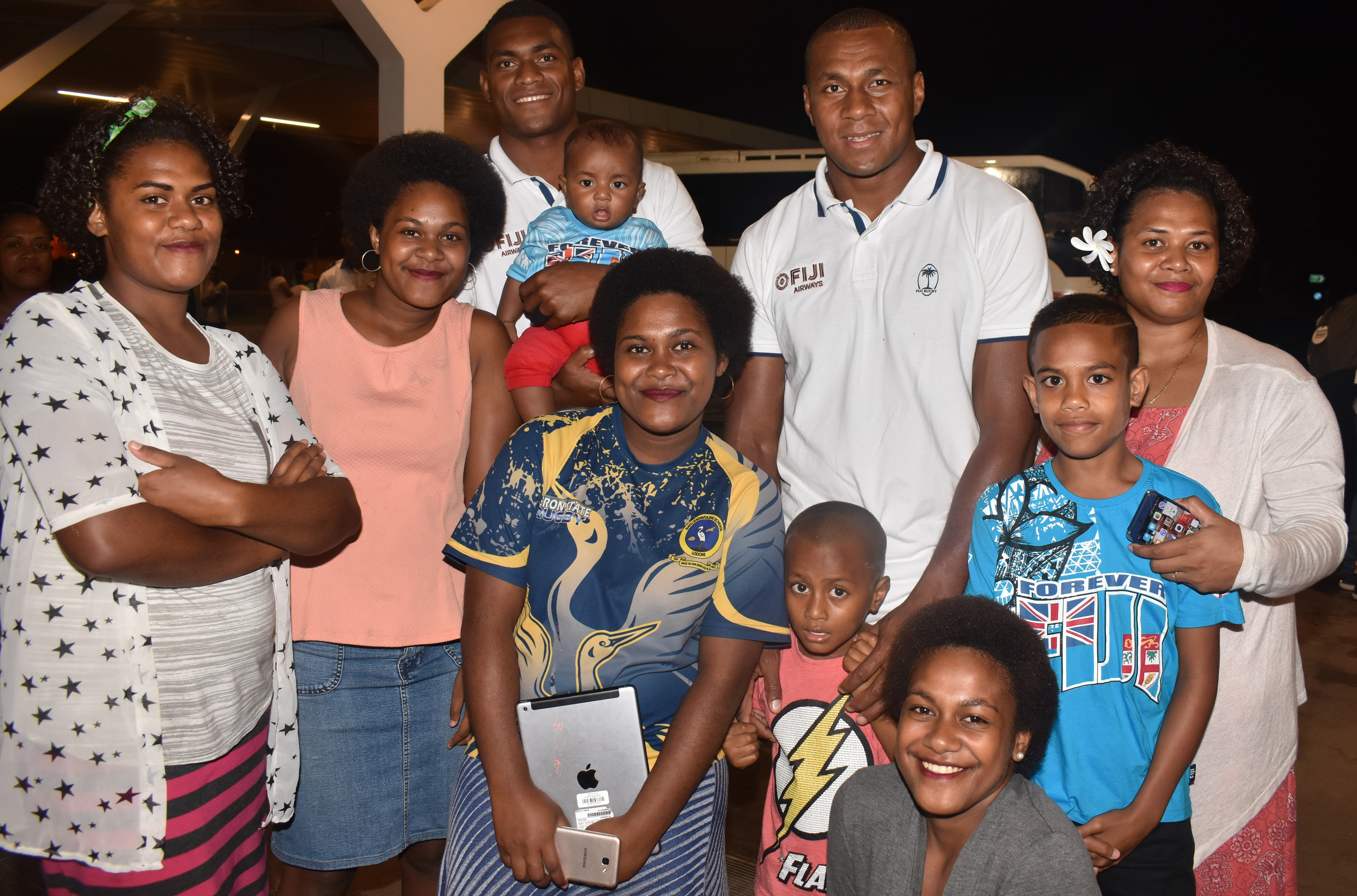 Fiji Airways 7's rep Mesulame Kunavula and Paula Dranisinukula with relatives at the Nadi International Airport on May 2,2018. Photo: Waisea Nasokia