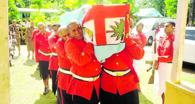 Republic of Fiji Military Forces personnel carry the casket of the late Warrant Officer Class One Josevata Muakalou at his village in Naila, Tailevu on May 4, 2018 . Photo: RFMF Media Cell
