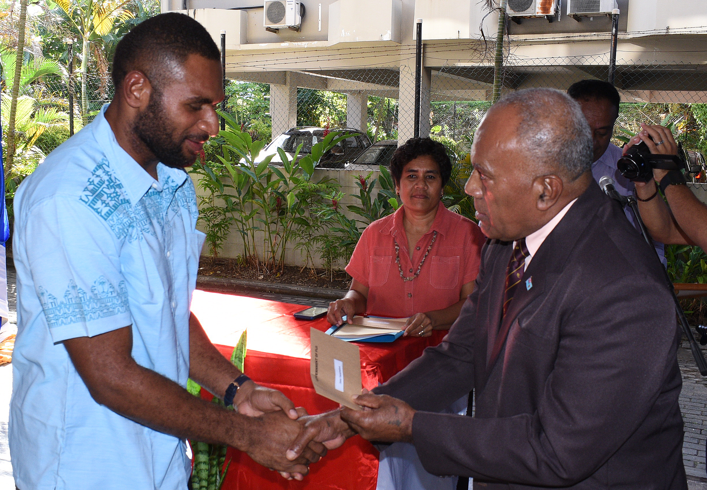 Fiji Airways Fijian 7s rep Jasa Veremalua(rep) receives his cheque from Minister of Youth and Sports Laisenia Tuitubou in Suva on May 9,2018. Photo: Ronald Kumar