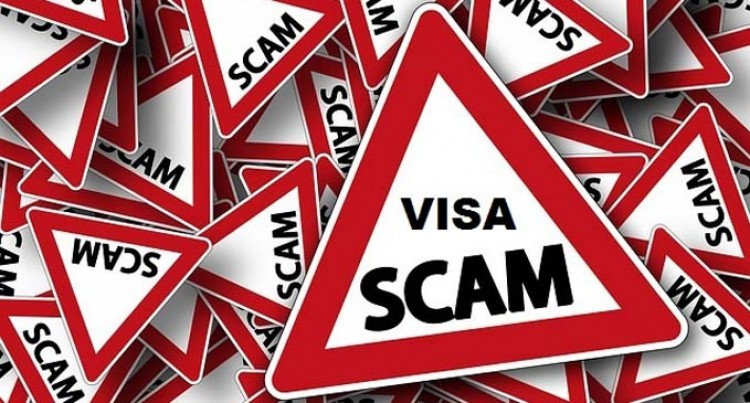 SACKED OVER VISA SCAM