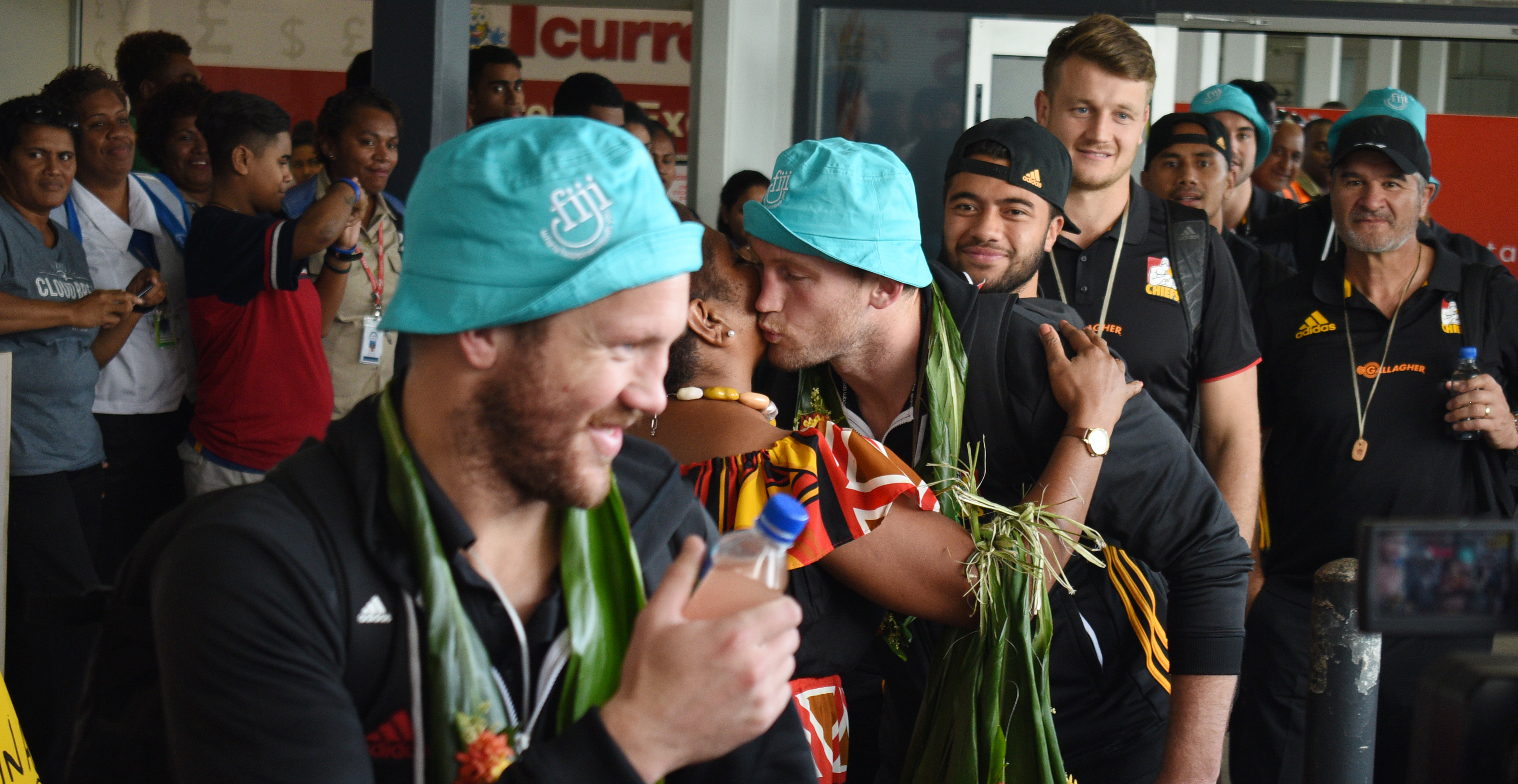 Chiefs Rugby players with local fans at Nausori International Airport on June 27, 2018.  Photo: Ronald Kumar.