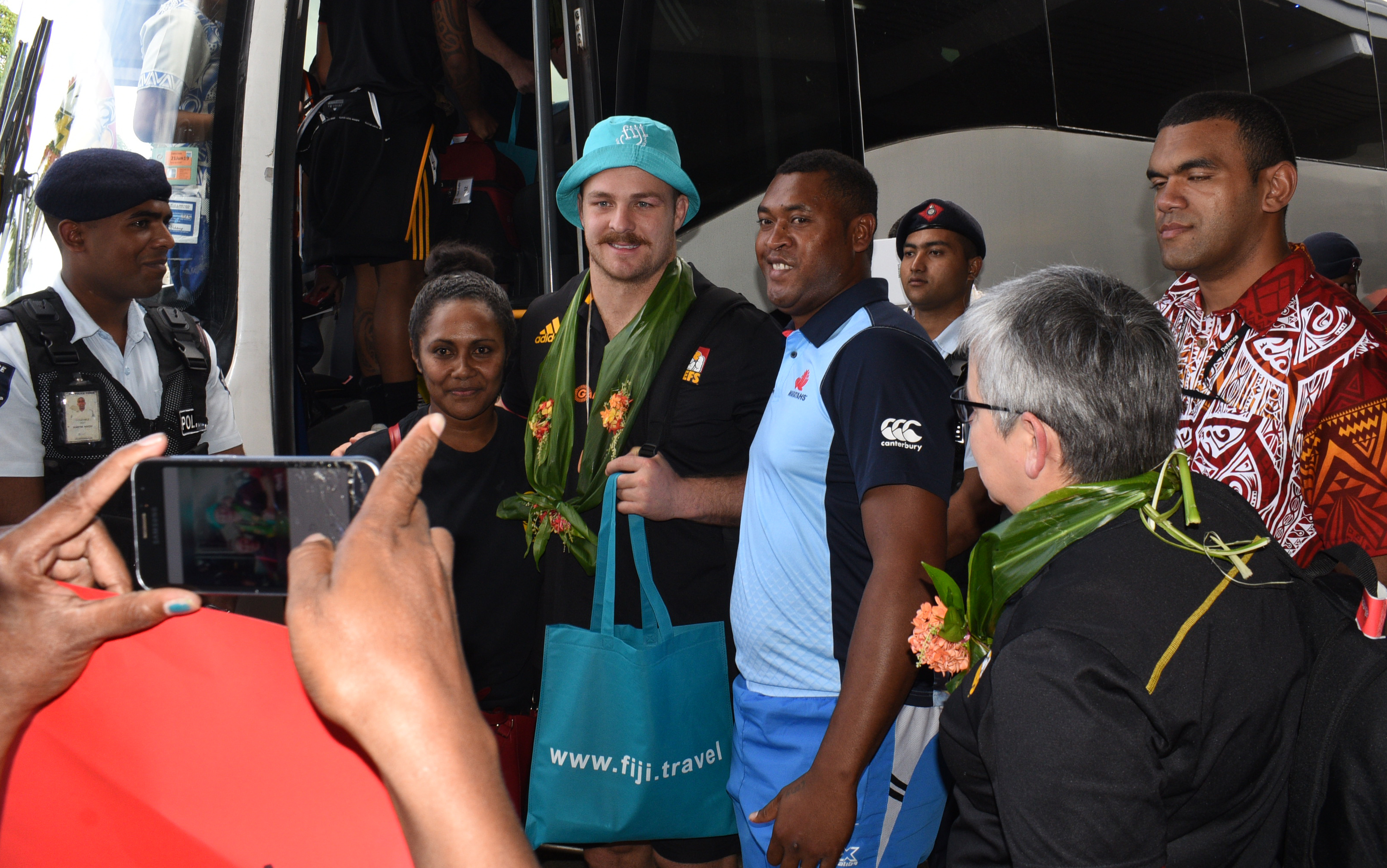 Chiefs captain Sam Cane with local fans Merewai Naqioteri and Koroi Misinari of Navua at Nausori International Airport on June 27, 2018. Photo: Ronald Kumar.