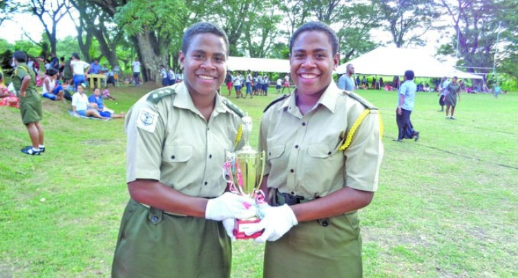 Twins Credit Dad For Cadet Officers' Award