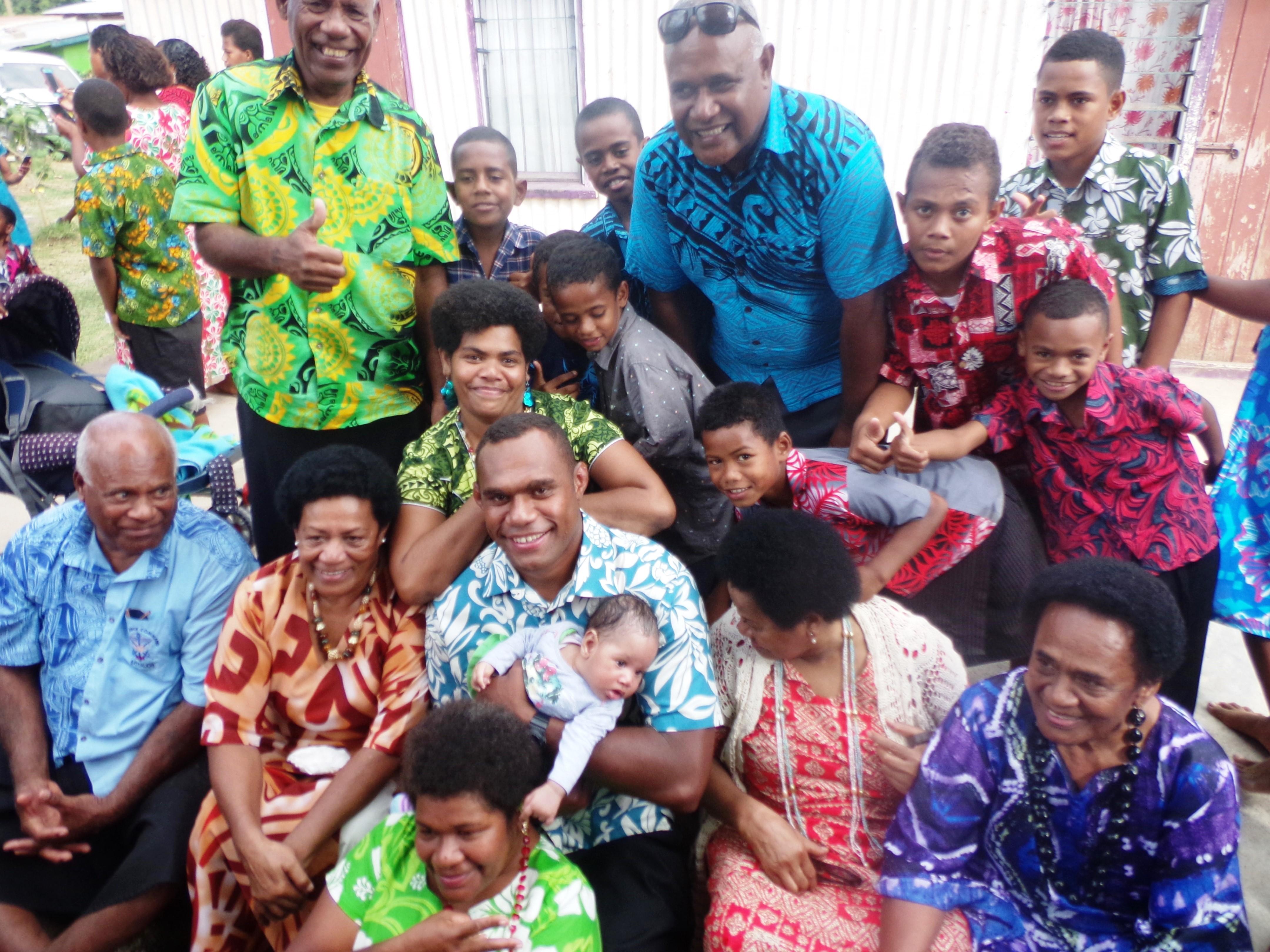 Fiji Airways Flying Fijians lock Leone Nakarawa is flanked by fans at Votua Village in Ba, on June 29, 2018. Photo: Peni Komaisavai