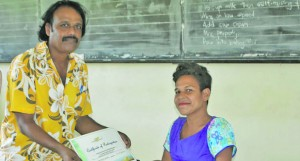 Youth Administrator-Macuata, Shalendra Bishma, handing a certificate to Angeline Bradburgh of the Fiji National Council for Disabled Persons. Photo: Nacanieli Tuilevuka