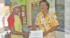 Youth Administrator-Macuata, Shalendra Bishma handing a certificate to Ravneet Prasad. Photo: Nacanieli Tuilevuka