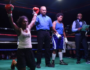 Women boxer Visila Kolitapa (left) celebrates her points win over Inise Kaunimara with referee Leca Fotu (middle) at Prince Charles Park,  Nadi on June 23, 2018.  Photo: Waisea Nasokia