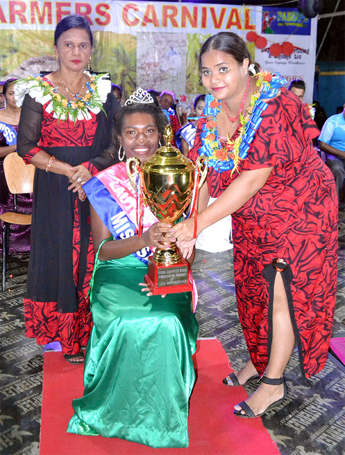 Miss Charity – Liliviwa Vakavoli (Miss Saweni Sector) receives her trophy during the Hasmat Investments Lautoka Farmers Carnival crowning night on June 16, 2018. Photo: Sanjay Gounder