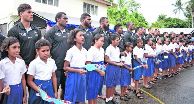Children Welcome Flying Fijians