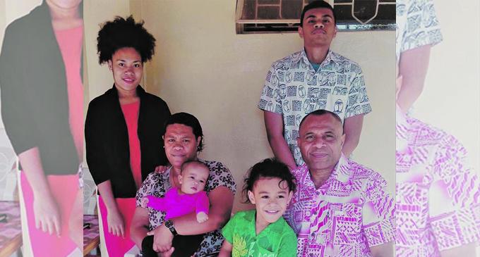Pastor Sakaraia Tamani Mataka(sitting right), son, Paula Tekei Mataka (standing right), and family