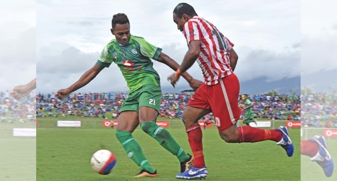 Labasa striker Christopher Wasasala (right) on attack while defender Sekove Naivakananumi of Jack's Nadi closes in during the Vodafone Fiji FACT tournament semifinal at Churchill Park, Lautoka on June 3, 2018. Labasa won 2-0. Photo: Waisea Nasokia