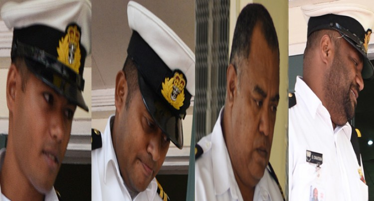 Navy Officer Demoted, Three Others Fined