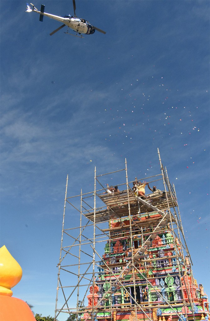 A chopper showers the temple towers with flowers during the 3rd Mahakumba Abhishekam Pooja at the Sri Siva Subramanya Swami temple in Nadi on June 17, 2018.  Photo: Waisea Nasokia