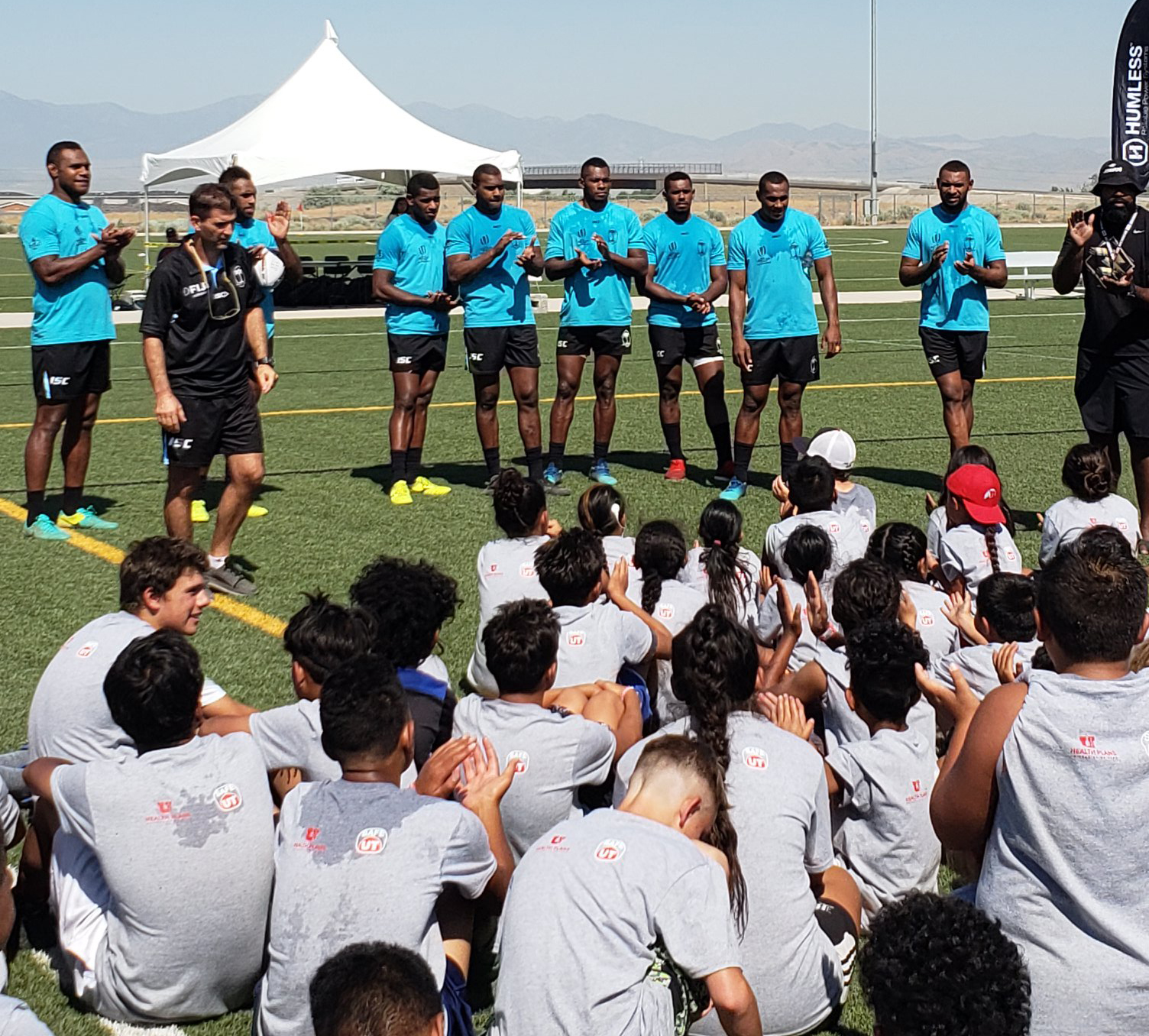 Fiji Airways Fijian  7s team talks to kids at the Utah Valley University clinic organised by the Pioneer Rugby  Foundation  at Salt Lake City. Photo: Pioneer Rugby Foundation.