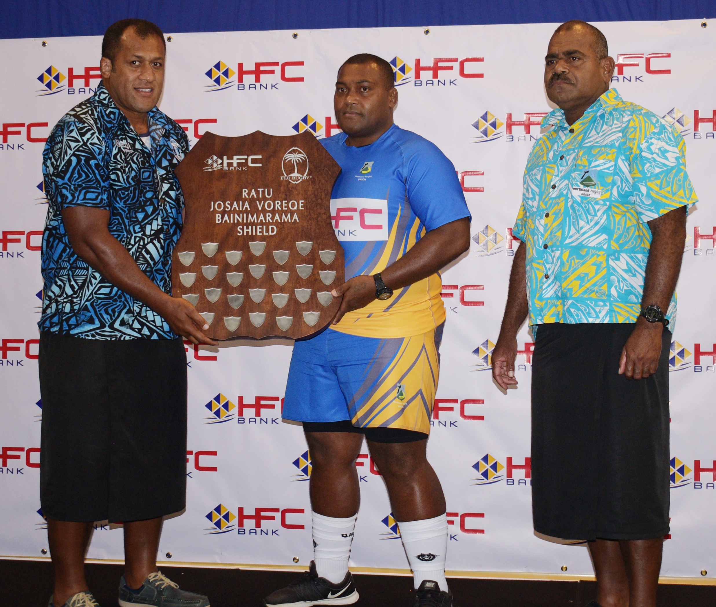 From left; Rewa team coach Ro Alivereti Doviverata presents the HFC Bainimarama Shield to Northland captain Dan Ligairi. On the right Northland coach Watisoni Ratulevu on July 18, 2018.  Photo:  Navneel Kumar