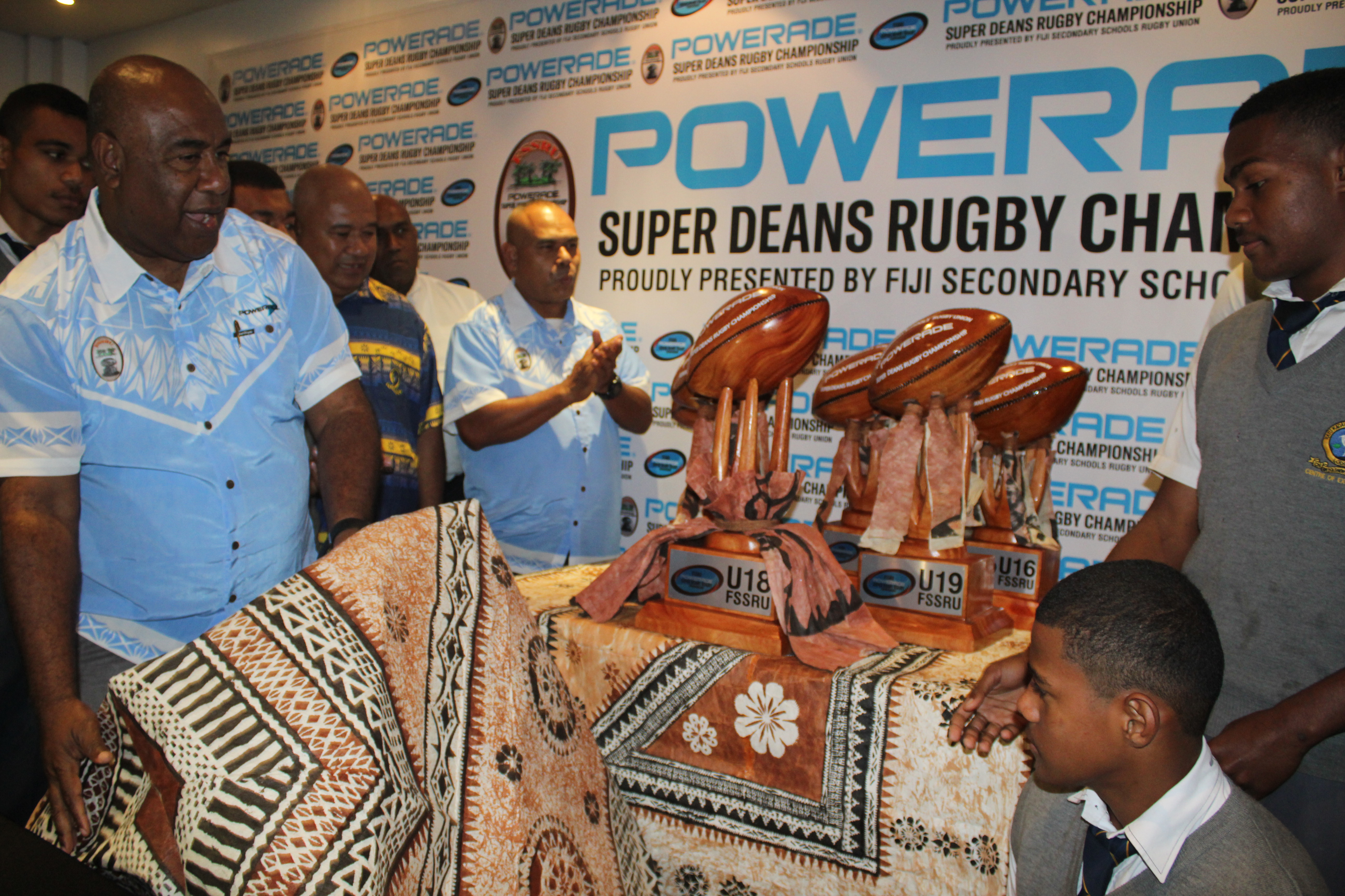 Fiji Secondary Schools Rugby Union president Setareki Merekula unveils the new trophies for the Powerade Super Deans Rugby competition at the Holiday Inn on July 26,2018. Photo:  Simione Haranavanua