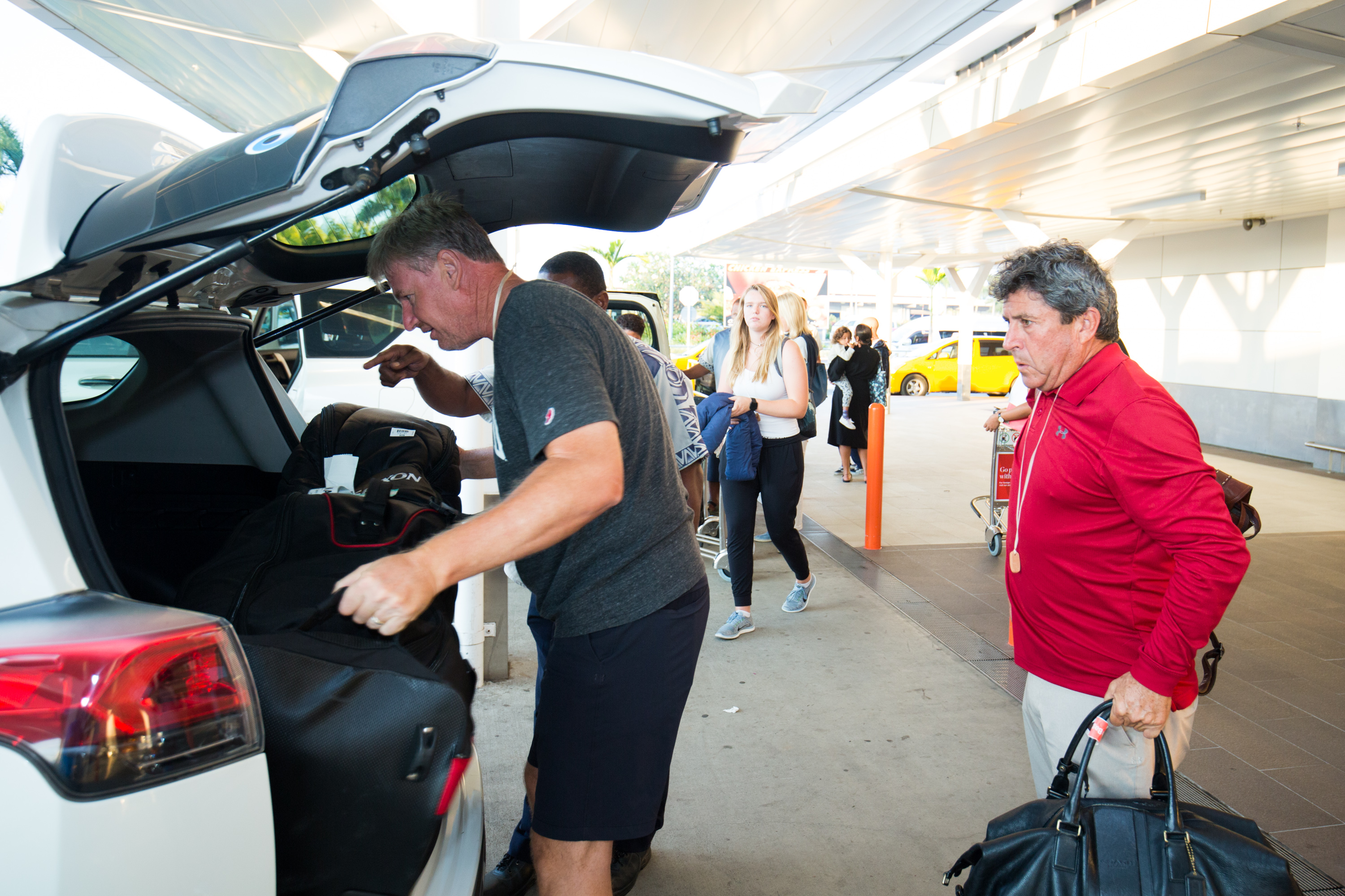 Ernie Els (left) loads his baggage while arriving at Nadi International Airport on July 30, 2018.  Photo: Fiji International