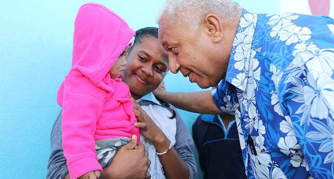 Prime Minister Voreqe Bainimarama with local community members in Wainunu, Bua, on July 2, 2018. Photo: DEPTFO
