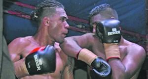Rakuro Daunivavana (left) and Sebastian Singh exchange punches in the main bout at Prince Charles Park in Nadi on July 13, 2018. Photo: Waisea Nasokia