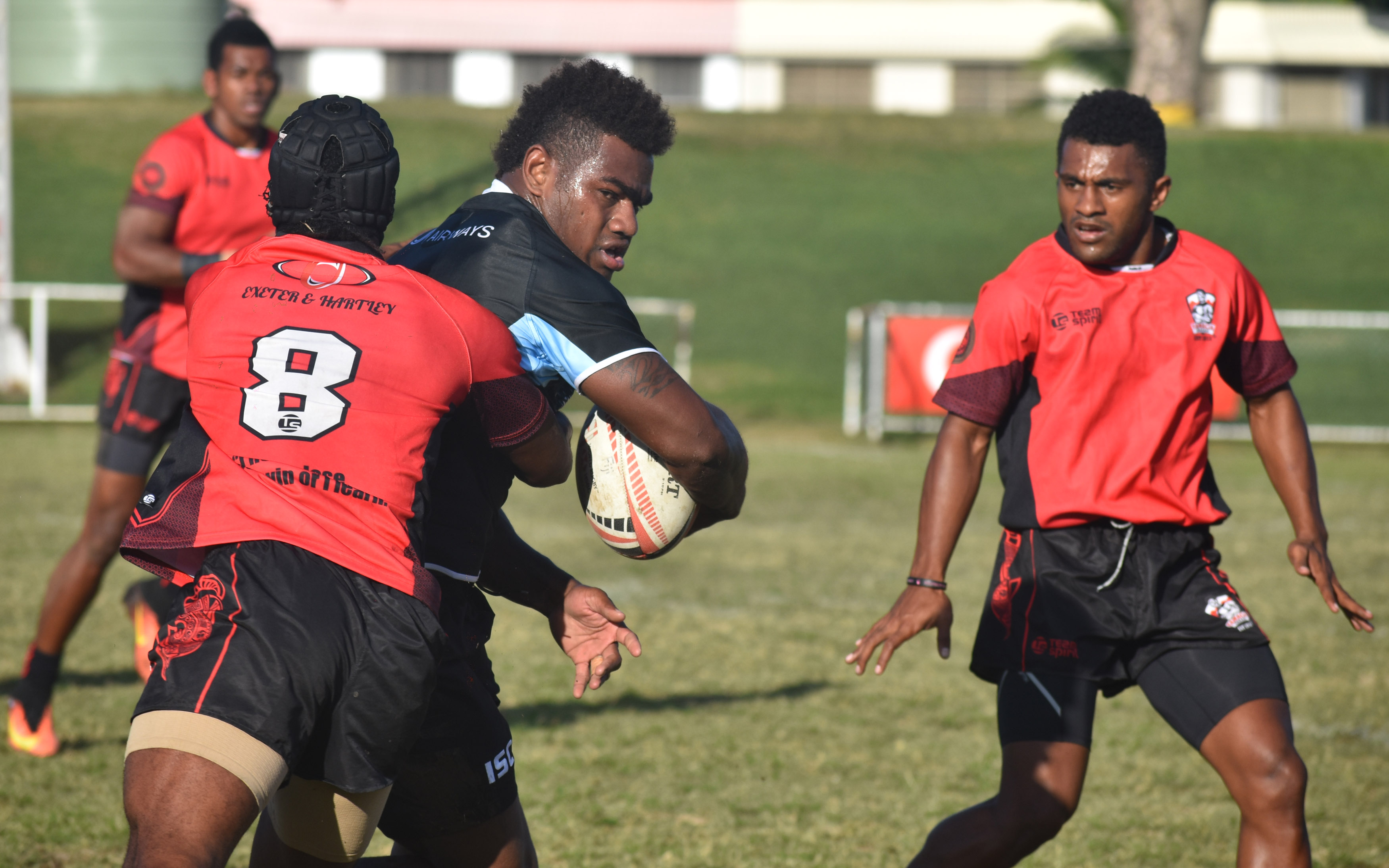 Fiji Airways 7's rep Josua Tuisova is tackled by a Yamacia player during their final training run at the Prince Charles Park in Nadi on July, 3, 2018.  Photo: Waisea Nasokia