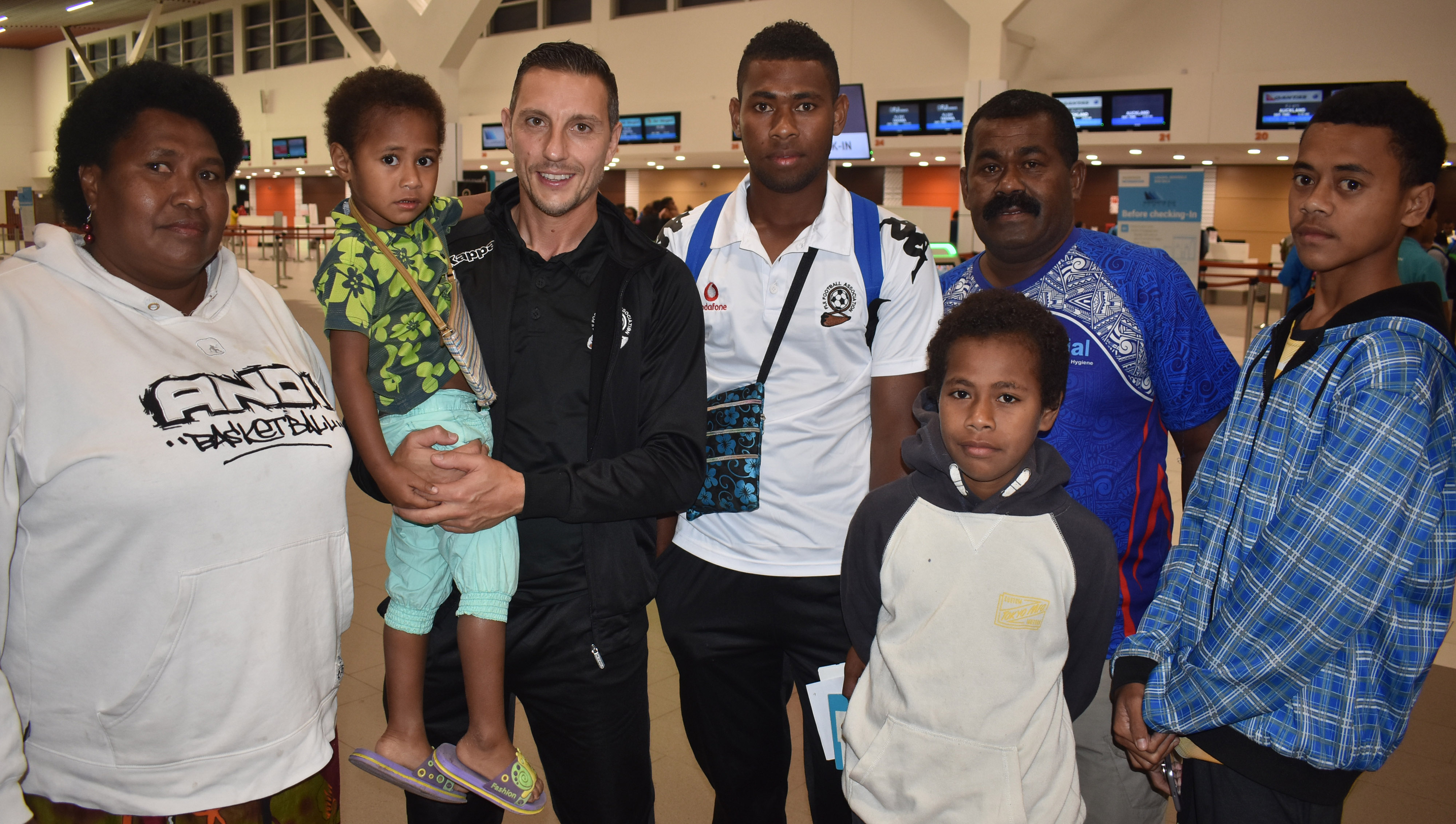 Vodafone Fijian football head coach Christophe Gamel (second from left) with Jovilisi Naborisi and his family at Nadi International Airport on July 2, 2018.  Photo: Waisea Nasokia