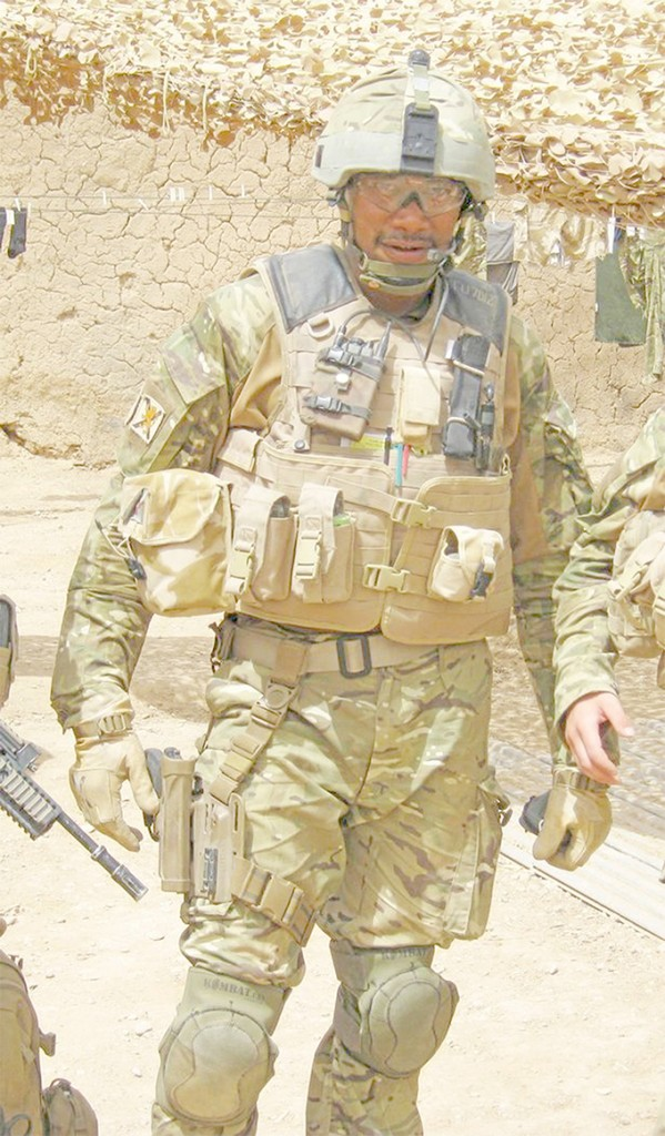The wife of Fijian Scottish soldier Jone Tuwaiwai (pictured fighting with the Royal Regiment of Scotland in Afghanistan) has alleged that her son has been subjected to racist taunts. Helen Marie O'Malley told the Daily Record newspaper about the racial abuse that those from Commonwealth nations and their families faced.  She revealed that adopted Scottish soldiers from countries such as Fiji, St Vincent and South Africa including their wives and children face racist physical and verbal abuse.  Photo: Daily Record