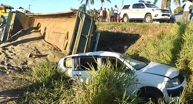 A 10 wheeler truck filled with fine sand on top of a probox truck in a ditch  after they were involved in an accident in Malolo, Nadi on 12 August 2018. PHOTO: ARIETA VAKASUKAWAQA