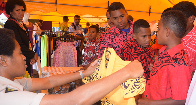 Sikeli Bari of Nadi trying a shirt at the correctional centre tent during the Methodist Church Annual confrence on August 13,2018.Photo:Simione Haravanua.