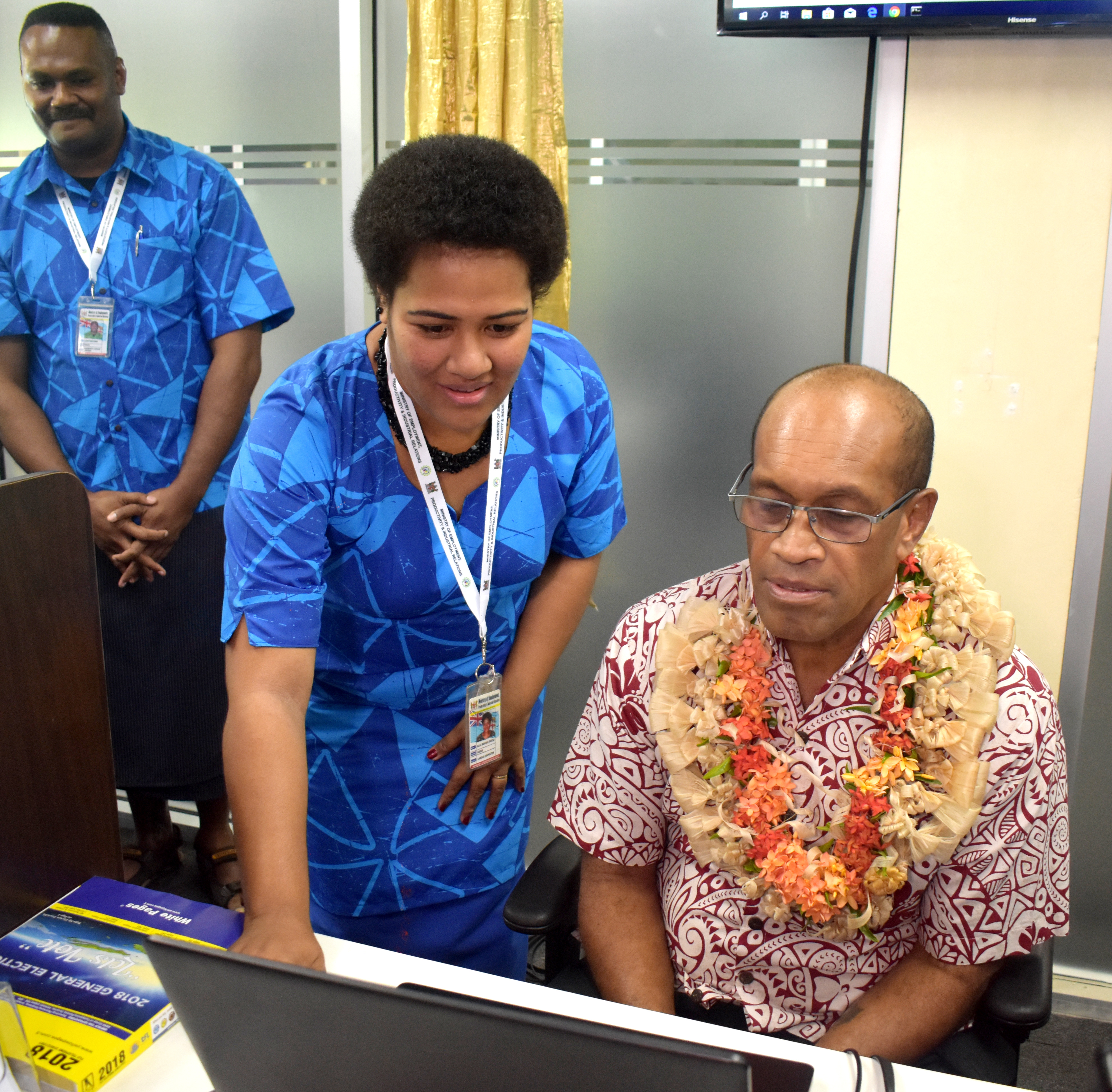 Customer employment service officer Ella Dresu assists the Minister for Employment, Productivity and Industrial Relations, Jone Usamate at the ministry's new customer service centre in Nadi.  Photo: Arieta Vakasukawaqa