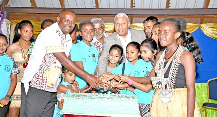 PM Praises School Community's Vision