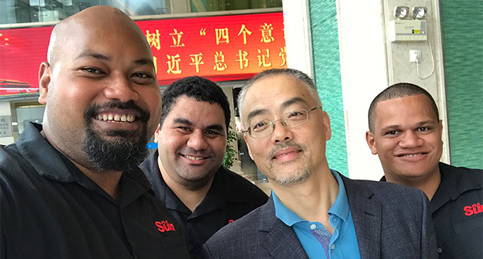 Atama Tamanilo (left), Jonathan Bryce with a representative from Guandong TV and Nacanieli Tuilevuka in China.