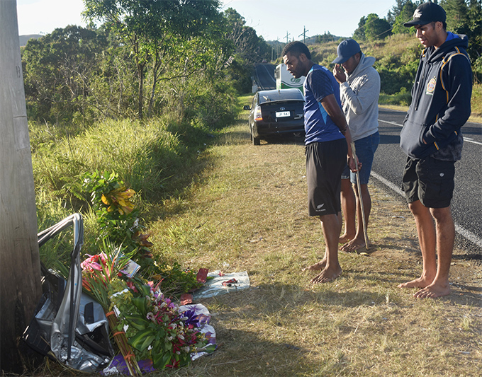 Marika Damuni (far right), with other old scholars of Ratu Navula College at the accident site in Nabou, between Nadi and Sigatoka on August 6, 2018. Flowers have been placed there.  Photo: Arieta Vakasukawaqa