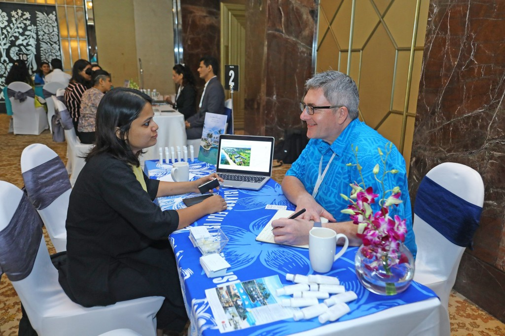Sofitel Fiji Resort & Spa director of Sales and Marketing, Michael Bell (right) assisting a guest during the annual India Roadshow in India Photo: Tourism Fiji