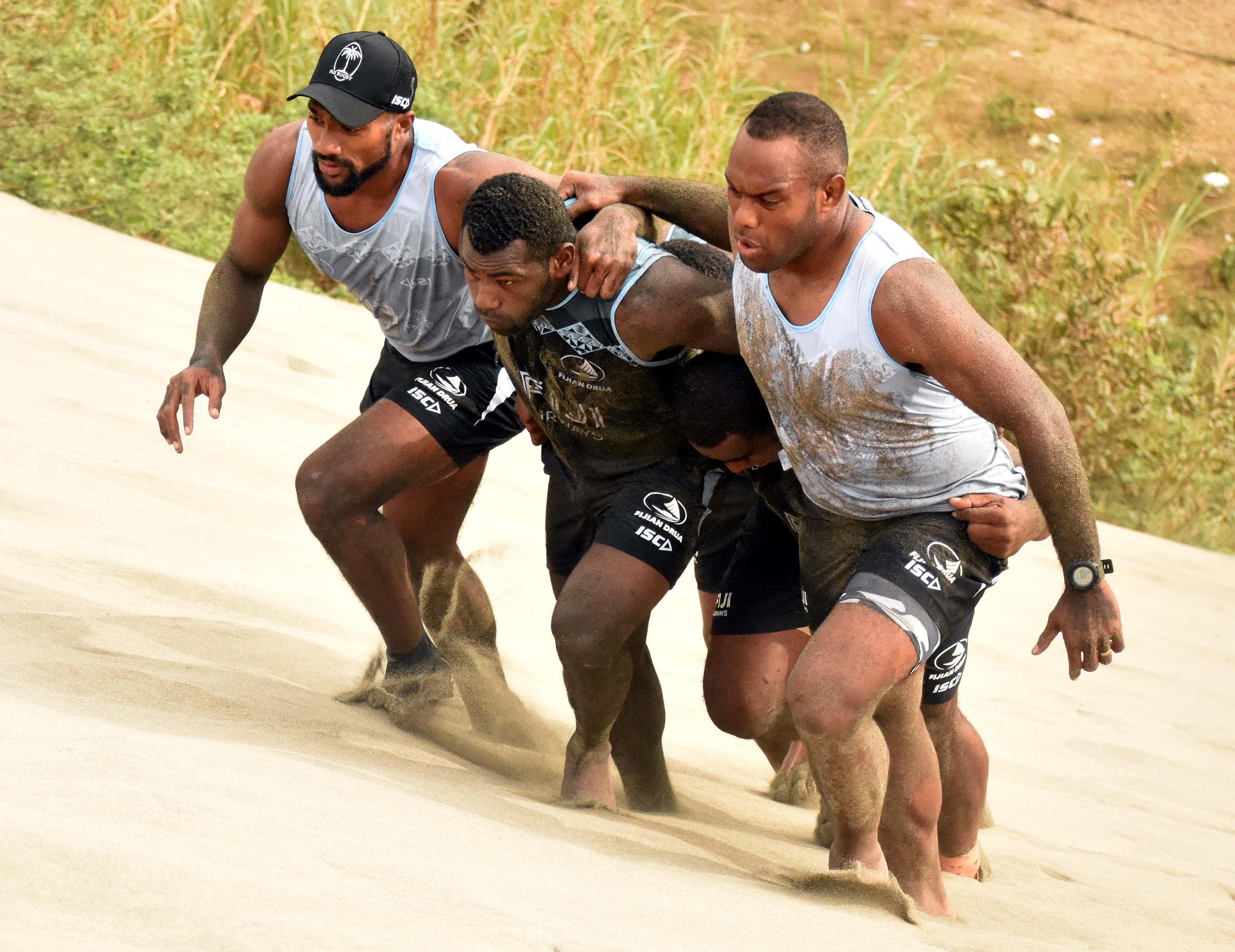 Fiji Airways Drua senior member Eremasi Radrodro (right) during training at the sand dunes in Sigatoka on August 18,2018. Photo: Waisea Nasokia