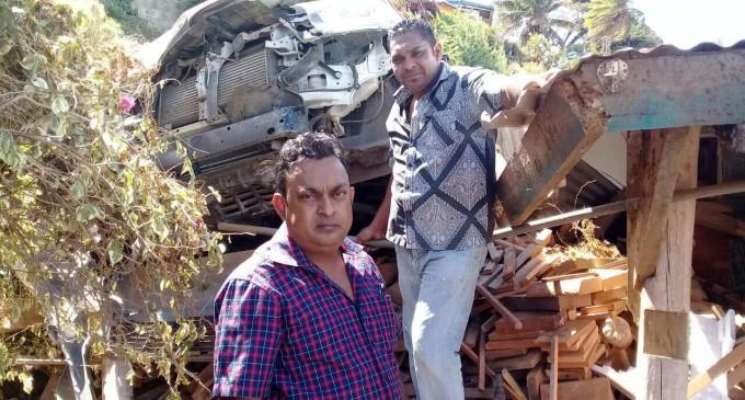 Four Witness Govt Vehicle Crash Near Garage