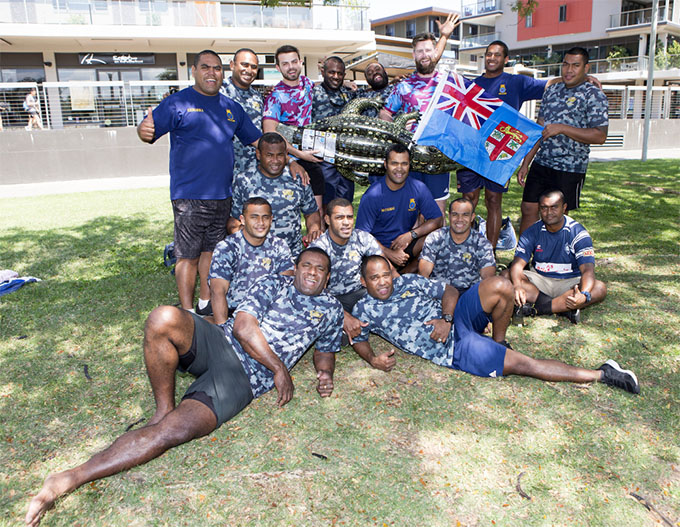 Sailors from HMAS Canberra (burgundy and blue shirts) and the Republic of Fiji Military Forces at the Exercise Kakadu 2018 Ocean Warrior Challenge held at Darwin's Waterfront.