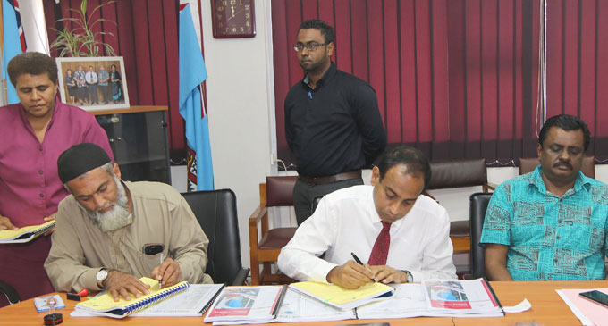 Contractor Taiyub Hussein (sitting left), Permanent Secretary for Local Government, Housing and Environment Joshua Wycliffe (sitting middle) and Minister for Local Government, Housing, Infrastructure and Transport Parveen Bala (right) at the contract signing for Nabouwalu to be developed into a town. Photo: DEPTFO News
