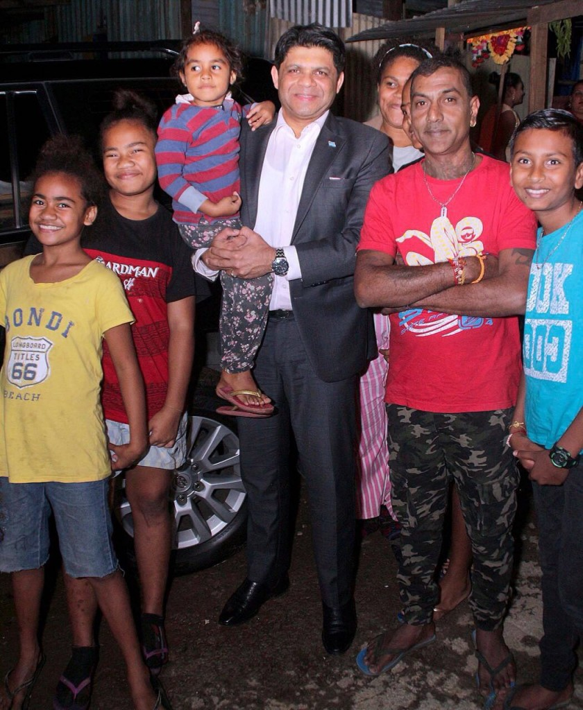 Attorney-General and Minister for Economy Aiyaz Sayed-Khaiyum with the community members of Namadai Settlement in Tamavua on August 31 2018