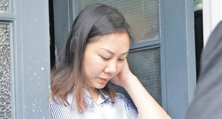 Chinese National's Case Awaits Interpreter