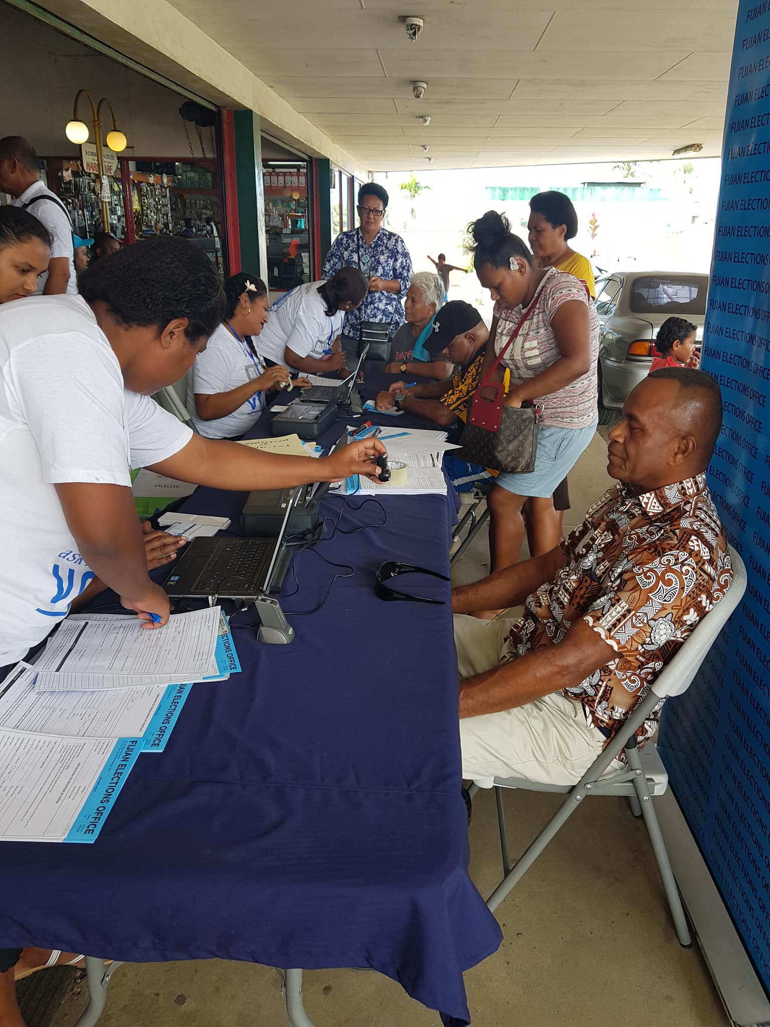 Fijian Elections Office officials assisted members of the public during the face-to-face voter awareness in Valelevu on September 22, 2018. Photo: Fijian Elections Office