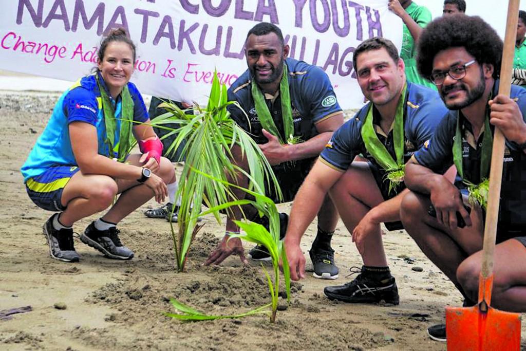 Fijian Wallabies rugby players Henry Speight (right) and Tevita Kuridrani (second from left) during a Kai Ni Cola initiative at Namatakula
