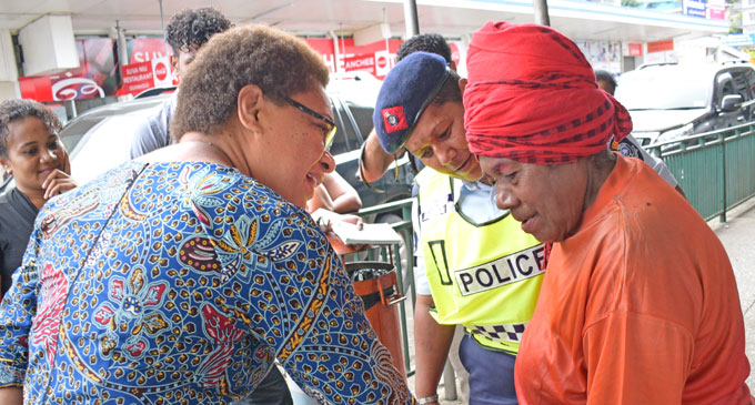 Minister for Women, Children and Social Welfare Mereseini street people Vuniwaqa (pictured left) with a Police officer assisting homeless woman Setaita Qalutaki in Suva on September 2, 2018. Ms Vuniwaqa took to the streets with her team and some Police officers to visit homeless people in the capital city. This was part of their work under the Loloma project. The programme coincided with Father's Day. Photo: Ronald Kumar