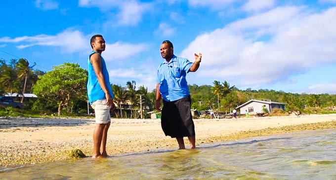 Ratu Ritova Baleilevuka and Mr Meli Kapawai look out to sea where the accident took place. Photo: Fulton Hogan Hiways