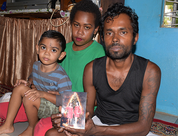 Sushil Chand with wife Litiana Marama and family member Dinesh Kumar with the picture of his two sisters Arti and Archana Chand, who were hit by a vehicle on September 16, 2018. Photo: Ronald Kumar
