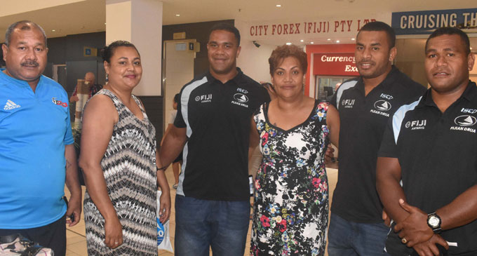 Members of the Fiji Airways Drua team with fans at the Nadi International Airport. Photo: Waisea Nasokia