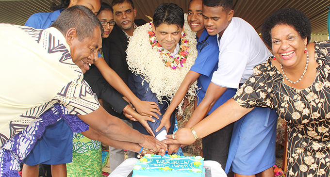 Stakeholder reps of the Waitui Cluster Education Partnership Model cut a cake to celebrate with Acting Prime Minister Aiyaz Sayed-Khaiyum.  Photo: Simione Haravanua