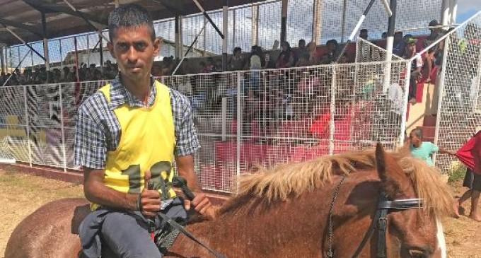 Jockey Celebrates 1-Mile Race Win