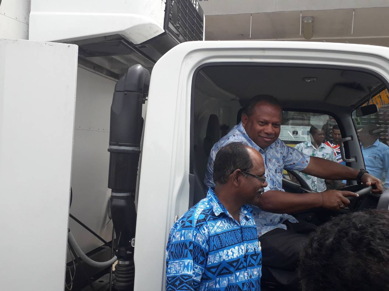 Minister for Agriculture, Rural and Maritime Development and National Disaster Management and Meteorological Services Inia Seruiratu inside the refrigerator truck with Madhwan Reddy standing. Photo: DEPTFO Ne